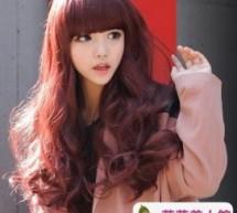 長臉女生優雅齊瀏海長卷髮型設計